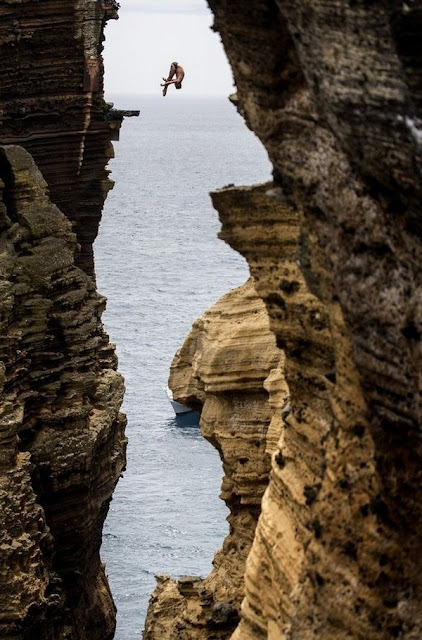 15Blake Aldridge dives 29 metres from the rock monolith during the Red Bull Cliff Diving World Series in Portugal