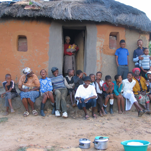 They eat dinner (maize meal, soup and spinach) and get together with their neighbours to chat.