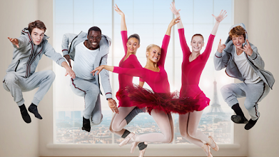 Cast of Find Me in Paris leaping into the sky