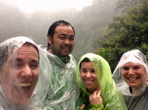 Four people in rain