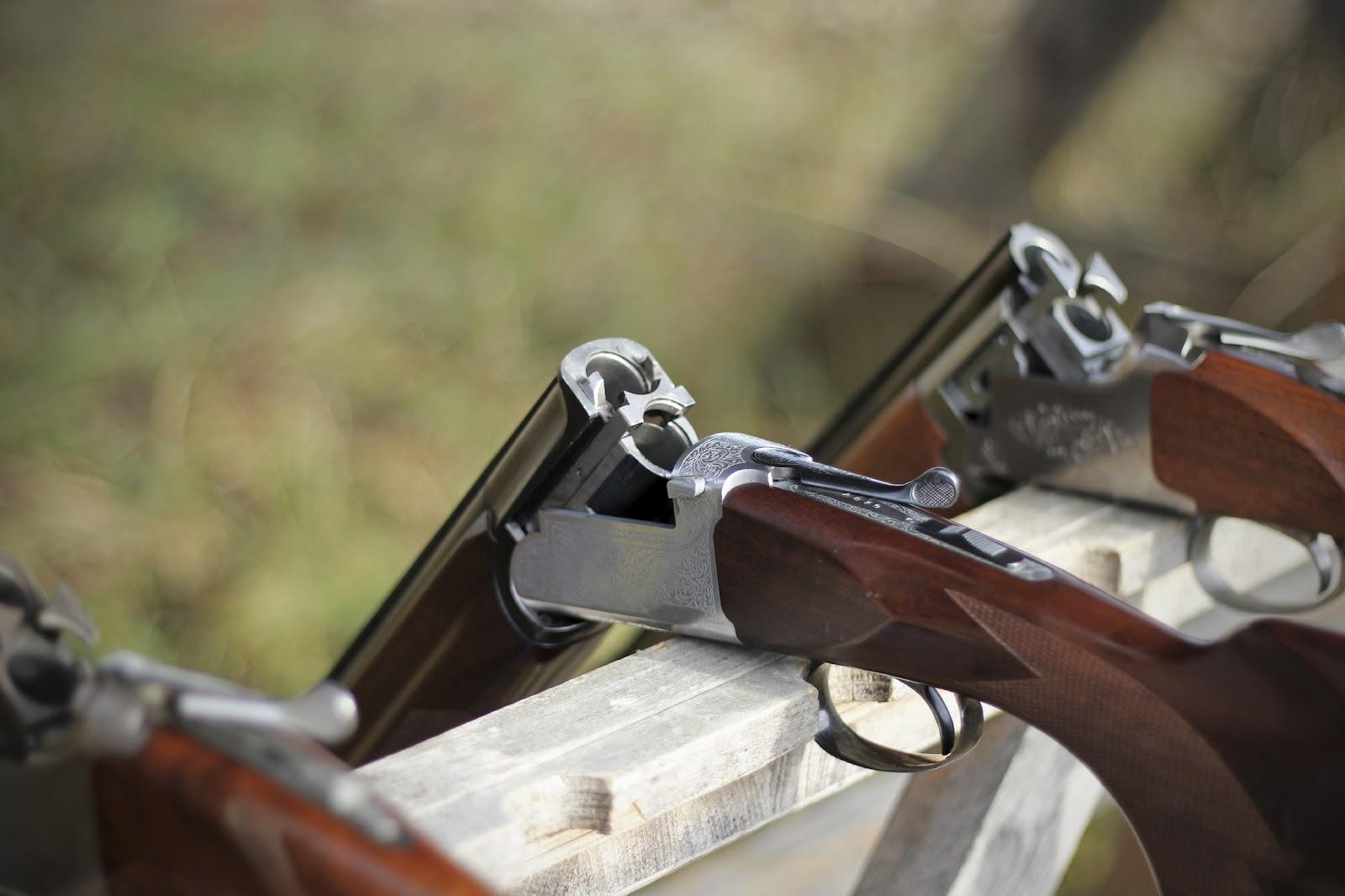 three shotguns on the bench