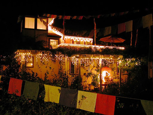 Kachoe Dechen Ling, CA, USA extensive light offerings at night