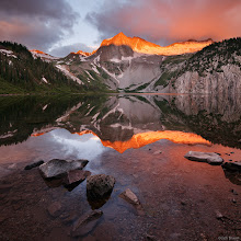 Photo: Brilliant alpenglow on Snowmass Peak and Snowmass Mountain (14,092 ft.), reflected in Snowmass Lake - July.