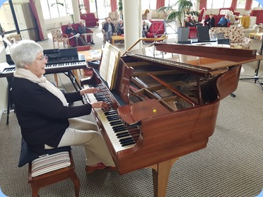 Claudette Wheeler gave us a mini-concert playing her beloved Steinway grand piano. Claudette is a resident of the lovely lifestyle Mayfair Village.