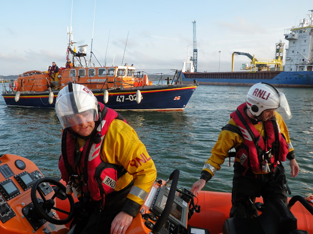 'Are you sure it's okay?' Poole ILB Helmsman Glen Mallen checking as Dolphin III is brought alongside the quay during a training exercise - 22 April 2014 Photo: RNLI Poole/Anne Millman