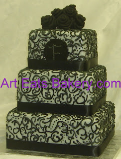 Four tier round black and white fondant lace culicue royal icing custom wedding cake design with silver edible vintage rose topper