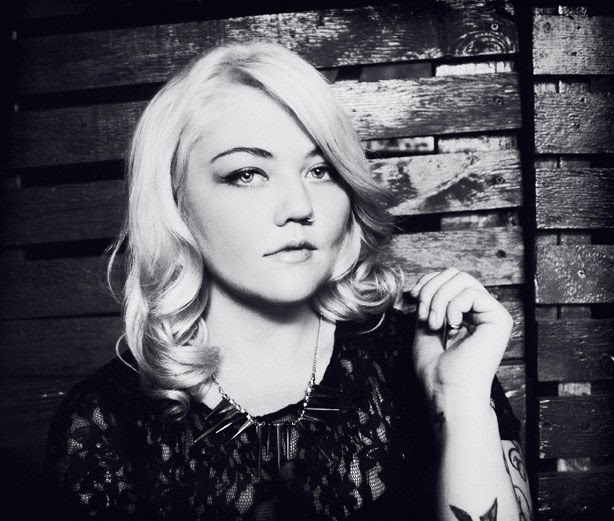 Vintage style black and white photo of Elle King in black lace dress.