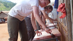 Volunteers building desks for the camp students