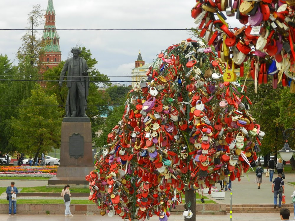 fake trees filled with love locks on the bridge to Bolotny Island