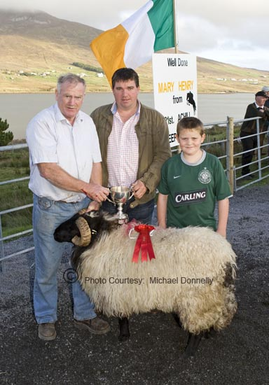 Sean Graven, Currane Achill, winner of the Hogget Ram (Open) class at the 21st Achill Sheep Show (Taispeántas Caorach Acla 2007) at Pattens Bar Derreens Achill is presented with the Mary Ellen Grealis Memorial Cup by Noel Grealis, included in photo is Seamus Tiernan. Photo: © Michael Donnelly