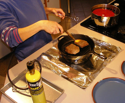 steaks were removed from the plastic bags and thoroughly seared on the outside in a cast iron pan with a gas MAPP torch