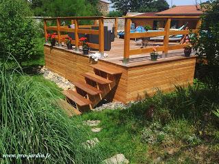 Un gros chantier, Terrasse en Ipé, bassin avec petit ruisseau, restauration d'un mur.