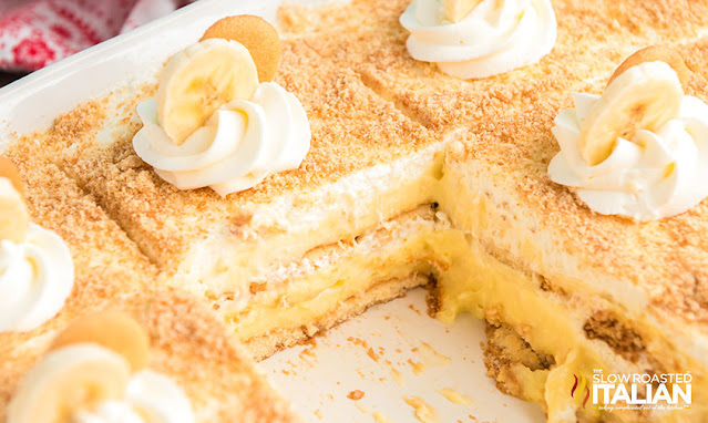 banana pudding cake with a slice cut out