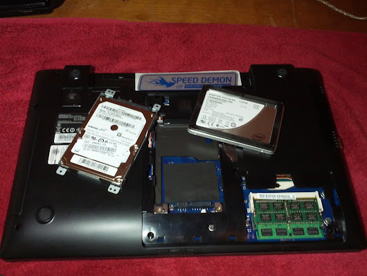 HDD and SSD on an open laptop