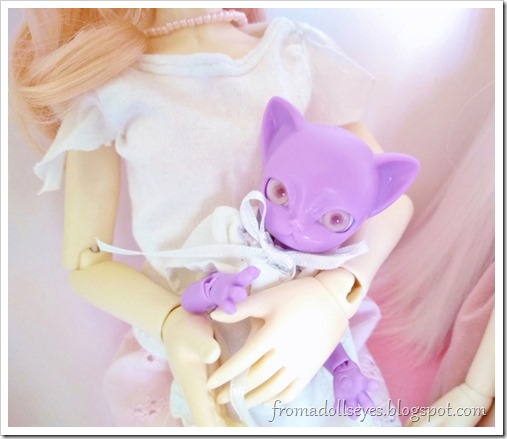 The purple kitty doll with her new pink eyes, now she can see at last.