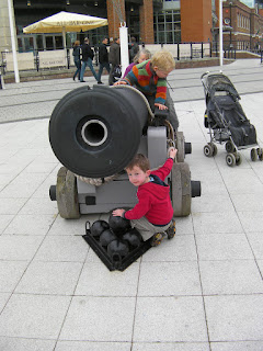 large naval cannon and cannonballs