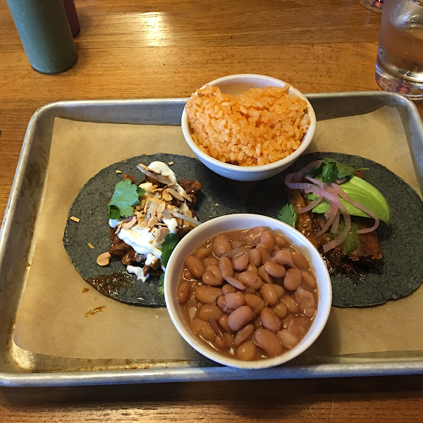 Delicious! Chicken taco on the left, carnitas on the right. Both fantastic but the chicken with the mole was my favorite! Excellent blue corn shells.