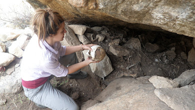 Photo: exploring a looted machay (tomb).