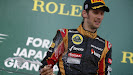 Romain Grosjean, Lotus F1, 3rd position, sprays Champagne on the podium