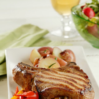 Stuffed Pork Chops with Beer-Glazed Onions.