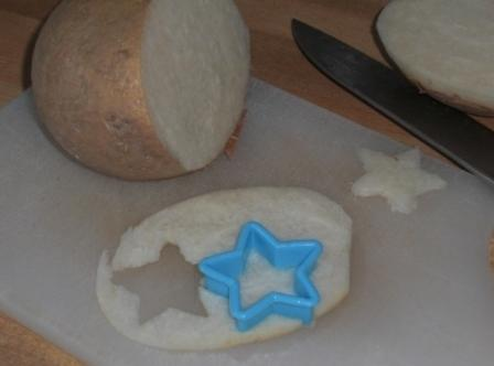 Take thinly sliced jicama and cut into stars.