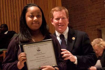 Misha Inniss-Thompson of Dwight Engelwood getting her award from Senator Robert M. Gordon.    Photos by TOM HART/  FREELANCE PHOTOGRAPHER.