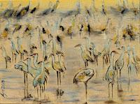 a flock of gray cranes