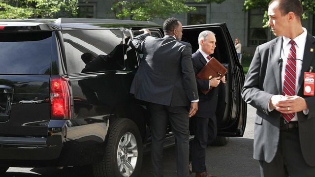 Environmental Protection Agency Administrator Scott Pruitt (2nd R) steps out of his armored SUV as he arrives to testify before the House Energy and Commerce Committee's Environment Subcommittee outside the Rayburn House Office in Washington, DC. Photo: Associated Press