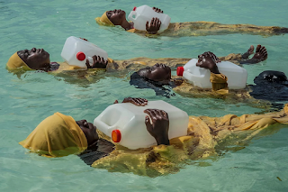 Color photograph of women floating in water