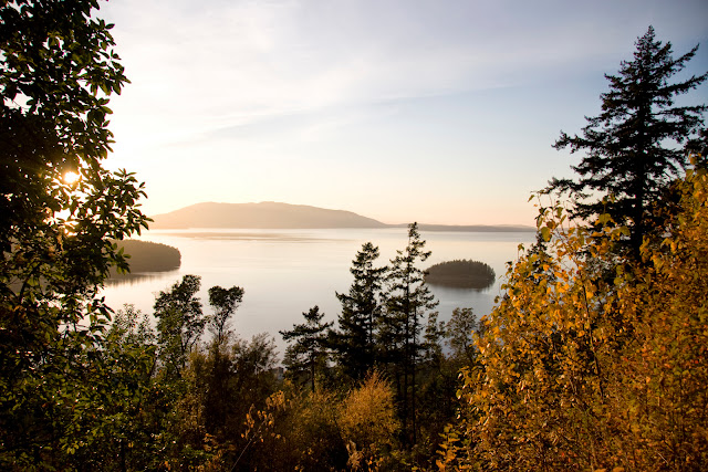 Twilight sinks into Chuckanut Bay and Dot Island, an archaeological site owned by the Nature Conservancy and well known for its visible shell miden, refuse from 10,000 years of native Salish people's use.Credit: Peter James