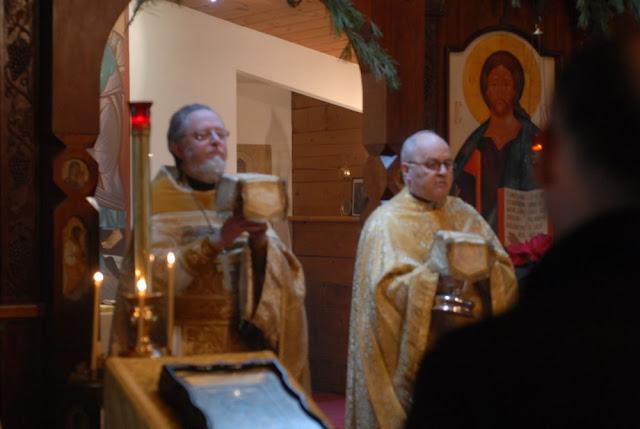 On Christmas Day, Fr. John concelebrates the liturgy with Fr. Joseph Konkus, a neighboring Orthodox priest.