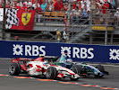 Anthony Davidson (GBR) Super Aguri F1 SA07 battles with Jenson Button (GBR) Honda RA107