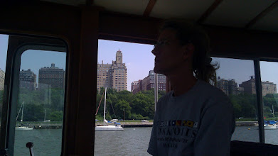 Photo: Lisa at the helm cruising up the Hudson River.