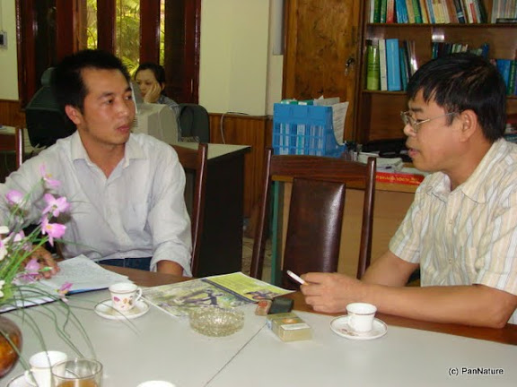 Consultation with the head of Conservation Section of Ha Giang Forest Protection Department on the design of Tonkin Snub-nosed Monkey poster.