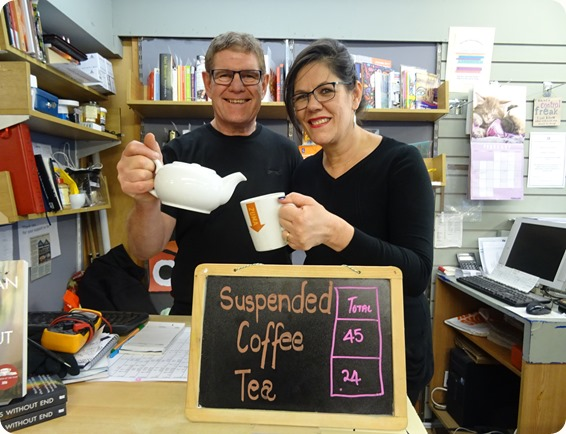 Denise and Steve Lawson with  Suspended Coffees board