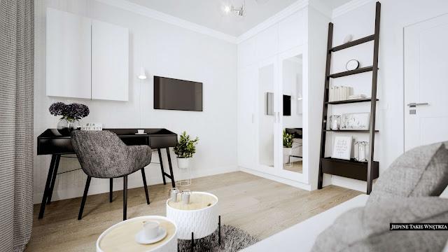 Domowy gabinet w stylu glamour, w którym znajduje się biała kanapa na czarnych nóżkach, miękki, włochaty dywanik oraz czarne biurko z błyszczącym blatem.