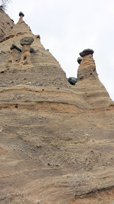Kasha-Katuwe Tent Rocks National Monument were formed by volcanic activity that then eroded over time into the cliffs, canyons, andcones of softer pumice and tuff often topped by a harder caprock, often resulting in fascinating rocks that appear to be barely balanced.