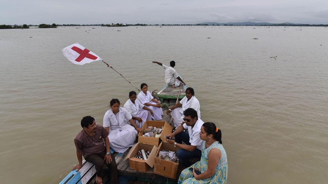 Medical officials of the Jhargaon Public Health Centre travel in a boat to a medical camp in flood-affected Morigaon district in India's northeastern Assam state on 18 August 2017. At least 221 people have died and more than 1.5 million have been displaced by monsoon floods across India, Nepal, and Bangladesh, officials have said. Photo: AFP