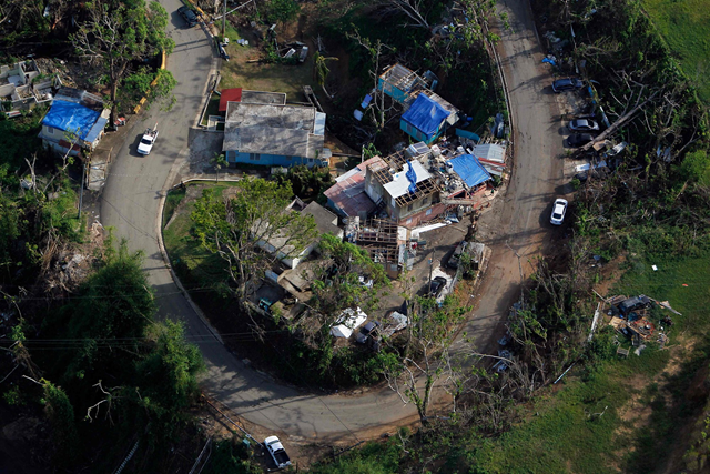 Aerial view of Houses damaged by Hurricane Maria in Naranjito, Puerto Rico, on 23 October 2017. Photo: Ricardo Arduengo / AFP / Getty Images