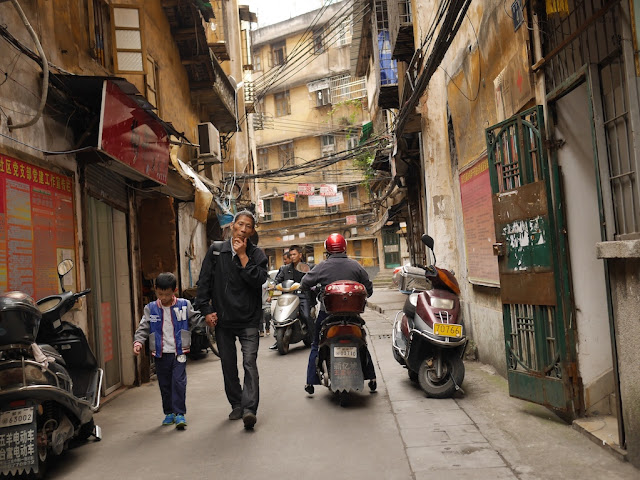 man walking with boy at Wuya Lane in Shaoguan, Guangdong