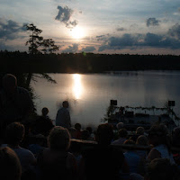 Sunset just before beginning of the concert at Bone Lake - by Hermann Thoene