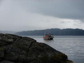 Photo: A crabber checking his traps off Texada Island.