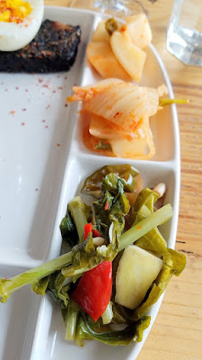 Han Oak brunch, banchan like kimchee and Sauteed and wilted greens