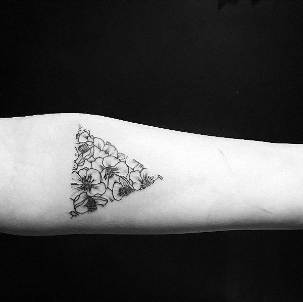 esta_repleto_de_flores_triangular_glifo