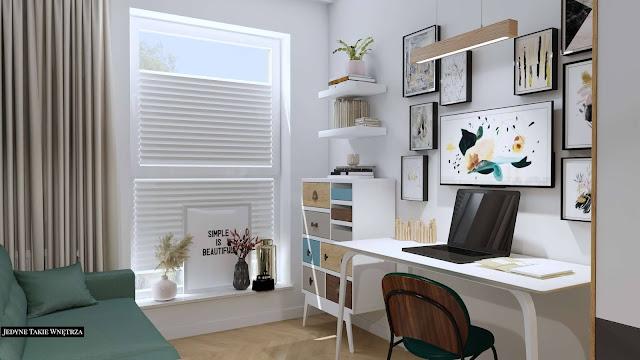Pastelowy, domowy gabinet, a w nim - białe meble, czarne krzesło oraz mozaika ze zdjęć na ścianie.