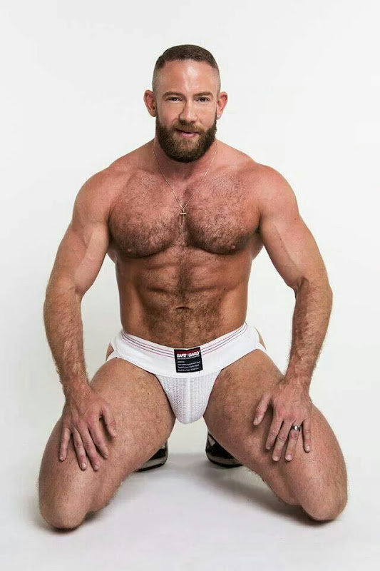 Muscled Hunk Sprays Bear