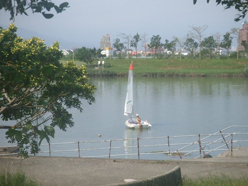Taiwan. Yilan county .A sailing dinghy on the river