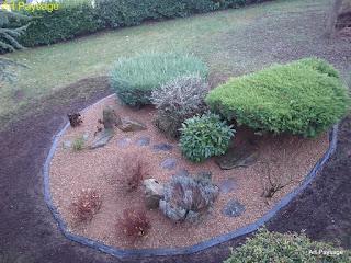 Ammenagement de rocaille, mur en pierre sèche, paillis minérale et massifs