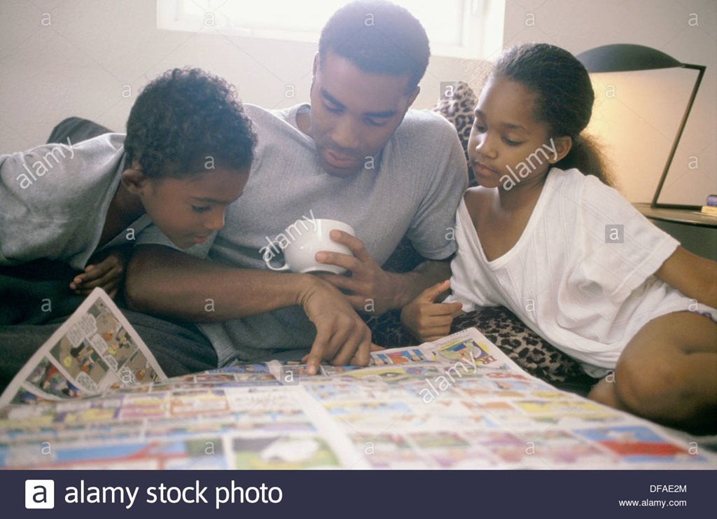 [african-american-father-and-children-reading-newspapers-comics-DFAE2M%5B3%5D]