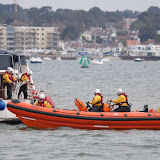 Two ILB crew members board a motor vessel that had drifted onto a sandbank between the Wych and Main Channels in Poole Harbour - 21 April 2013.  Photo credit: Dave Riley